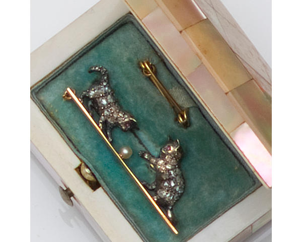 A diamond set kitten bar brooch