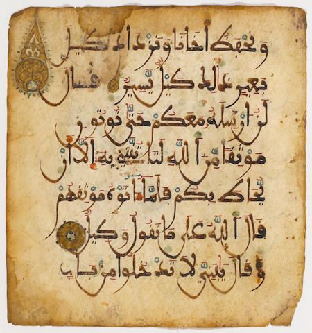 Three vellum Qur'an leaves in maghribi script (surat Yusuf (XII), verses 56-65 and verses 65-68) North Africa or Andalusia, 13th/14th Century(2)