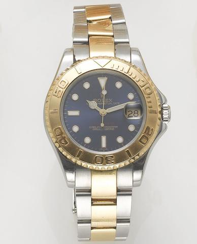 Rolex. A fine lady's stainless steel and gold mid size automatic centre seconds calendar bracelet watch Yacht Master, 1997