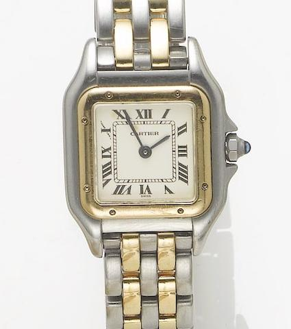 Cartier. A lady's stainless steel and gold bracelet watch with fitted box  Panthere, sold January 21st, 2000