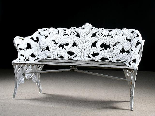 A pair of Victorian Coalbrookdale 'Fern & Blackberry' pattern cast-iron and wooden garden seats, circa 1870