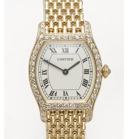 Cartier. A fine lady's 18ct gold diamond set tonneau cased bracelet watch Tortue, recent