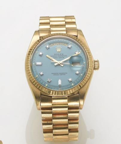 Rolex. A fine 18ct gold diamond set automatic centre seconds calendar bracelet watchDay-date, 1970's