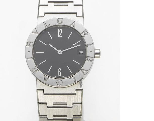 Bulgari. A stainless steel calendar bracelet watch with fitted box  Sold August 1st, 1998 in Harrods