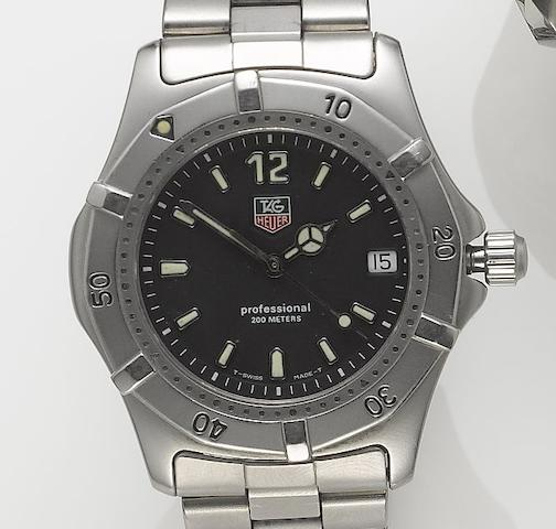 Tag Heuer. A stainless steel centre seconds calendar bracelet watch  Recent