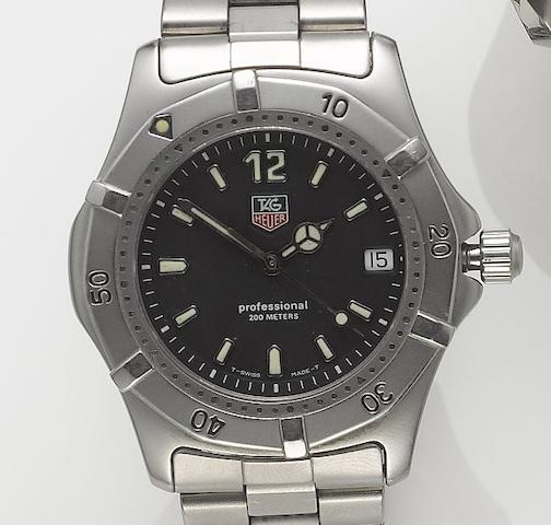Tag Heuer. A stainless steel centre seconds calendar bracelet watch  Recent