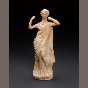 A large restored terracotta female figure