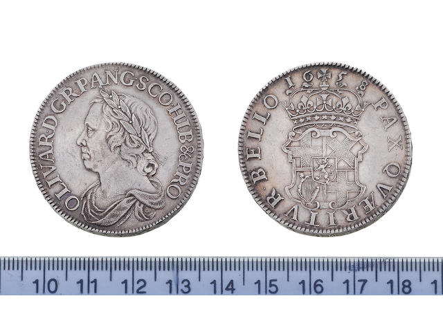 Oliver Crowmwell, Crown, 1658, 30.0g, laureate and draped bust left, with die flaw across breast,