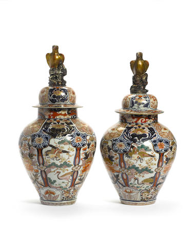 A fine pair of Japanese Arita baluster Jars and Covers circa 1700