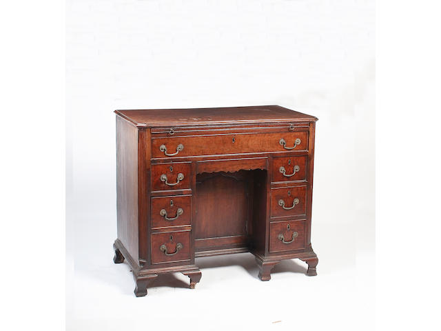 A mid 18th century mahogany kneehole dressing table,