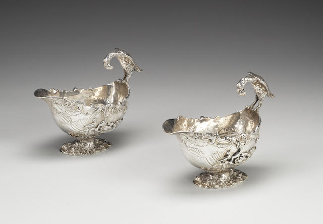 A pair of George III silver rococo revival sauce boats, by William Pitts, London 1814, also stamped