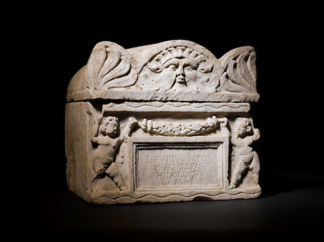 A Roman marble lidded cinerary urn