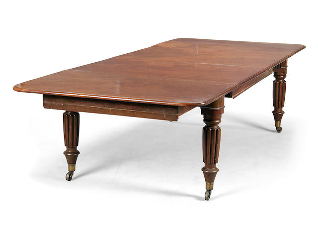 An early Victorian plum pudding mahogany extending dining table circa 1840