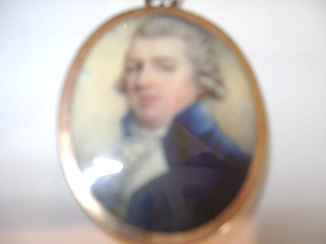 English School, circa 1785, A double-sided miniature of a Gentleman and a Lady; he wearing blue coat with frilled white cravat, his hair curled and powdered; she wearing white dress, her brown hair curled and upswept