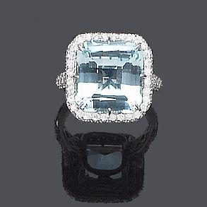 A blue topaz and diamond dress ring