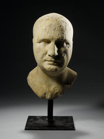 A Roman marble bust of an Isis priest