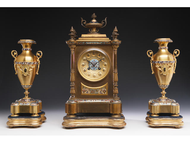 A late Victorian gilt metal and enamel clock garniture