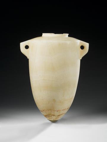 An Egyptian alabaster torpedo vase