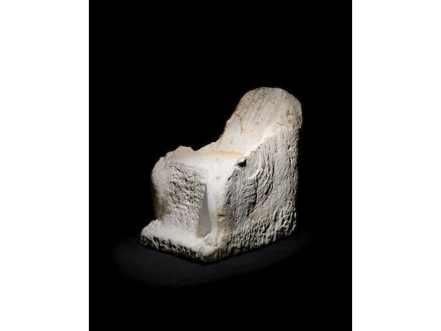 A Roman marble dedicatory throne