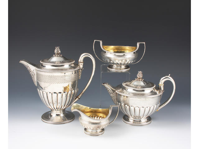 A George III silver four piece tea set The teapot and hot water pot with maker's mark for Peter and William Bateman, London, 1806, the sugar bowl and cream jug also, London, 1806 but maker's mark indistinct,  (4)