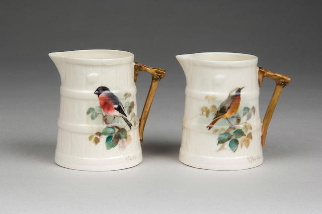 A pair of Royal Worcester jugs