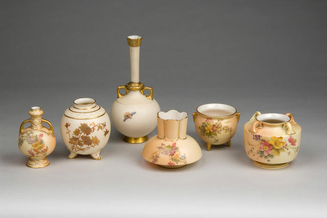 A group of six Royal Worcester ivory and blush ivory vases