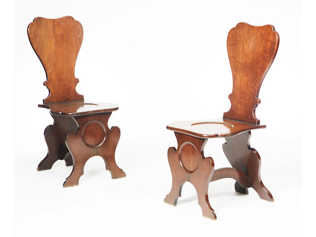 A pair of Georgian mahogany hall chairs
