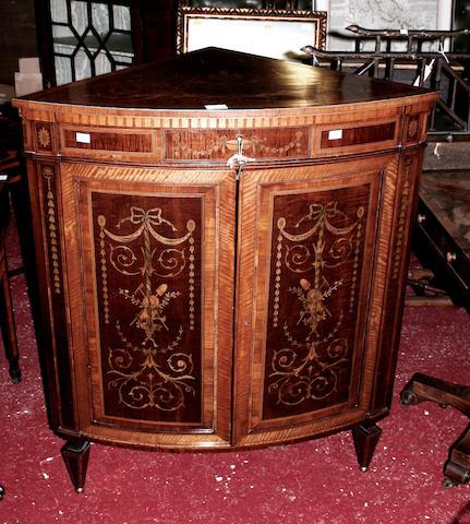 An Edwardian mahogany floor standing corner cabinet