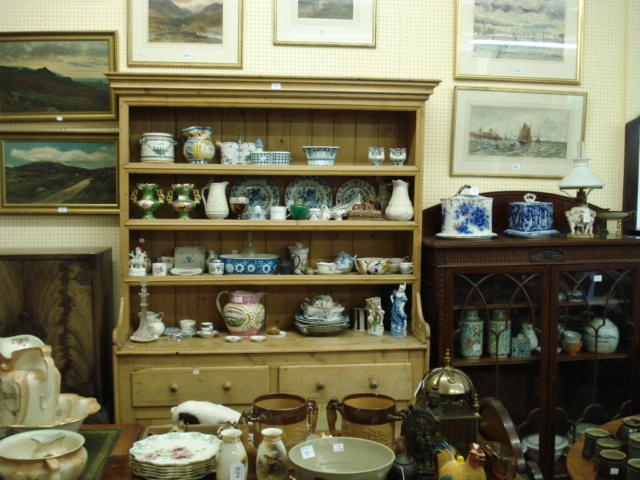 An early 19th century stripped pine dresser,