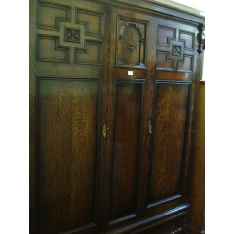 A circa 1920s oak wardrobe and dressing chest,