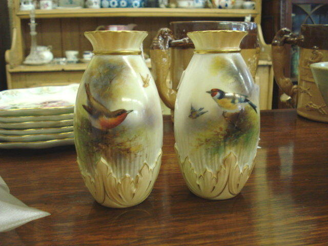A pair of Royal Worcester posy vases,
