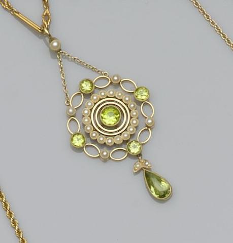 A 15ct gold half pearl and peridot pendant