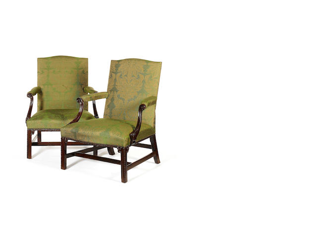 A pair of George III carved mahogany 'Gainsborough' Open Armchairs