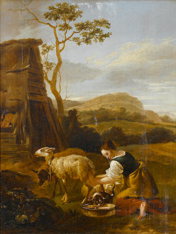 Attributed to Jan Baptist Wolfaerts (Antwerp 1625-circa 1687) A peasant girl milking a goat
