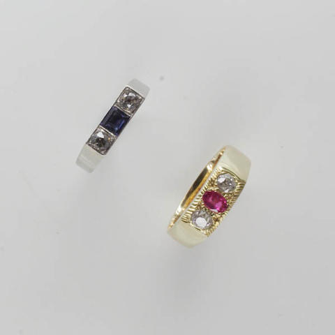 An 18ct gold ruby and diamond three stone ring (2)