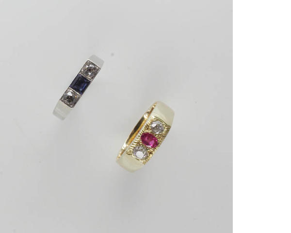 An 18ct gold ruby and diamond three stone ring