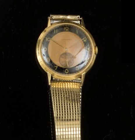 Longines: An 18ct gold round cased bracelet watch 1940's