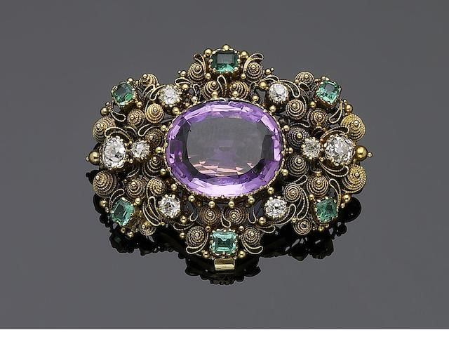 An early Victorian topaz, emerald and diamond brooch