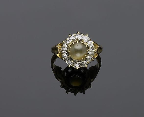 An early 20th century chrysoberyl catseye and diamond cluster ring