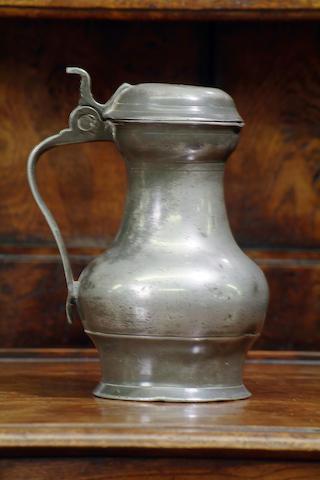A Scottish lidded pot belly measure, circa 1700