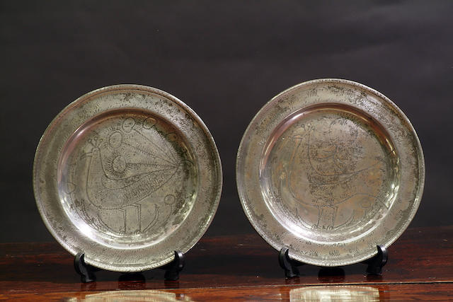 A fine pair of wrigglework marriage plates, circa 1720