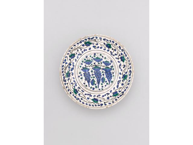 """A fine Iznik pottery """"Grape Dish"""" Turkey, circa 1550"""