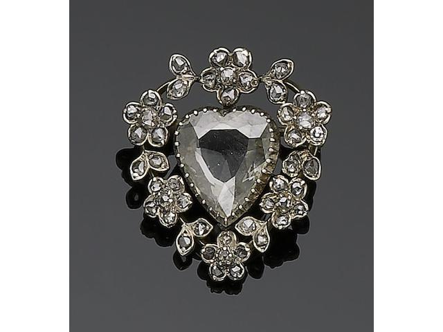 A diamond memorial brooch,