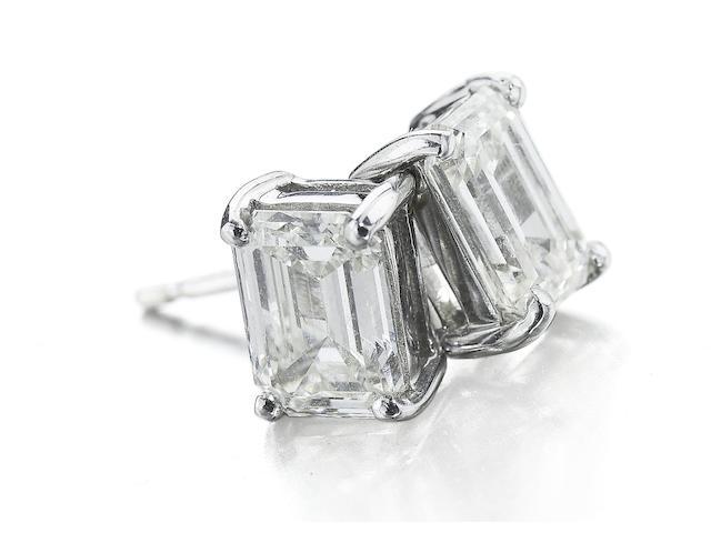 A pair of octagonal-cut diamond single-stone earrings