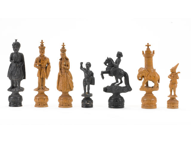 A carved boxwood figural chess part-set, Switzerland, circa 1870,