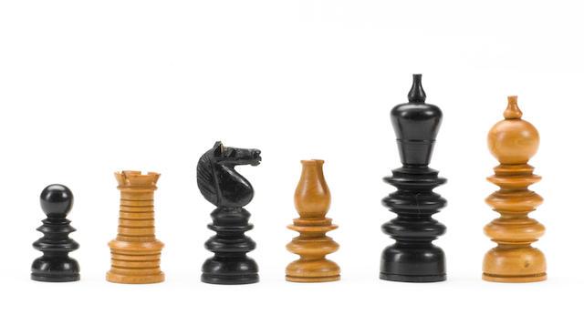 A boxwood and ebony chess set, presumably German or Austrian, late 19th century,
