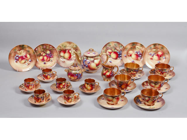 A late 20th century matched Royal Worcester tea and coffee set decorated with fruit,