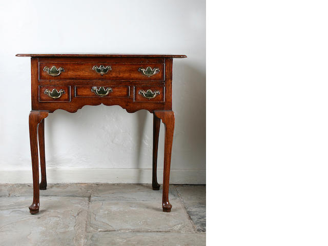 A George III oak and mahogany crossbanded lowboy, circa 1760,