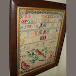 Two Victorian framed alphabetic samplers