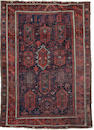 A Belouch rug Persian Afghan border, 7 ft 2 in x 5 ft 1 in (218 x 155 cm)